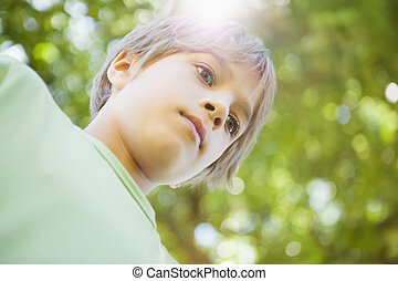 Low angle view of a boy at park - Low angle view of a young...