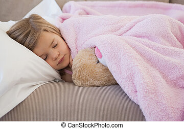 Close-up of a girl sleeping on sofa - Close-up of a young...
