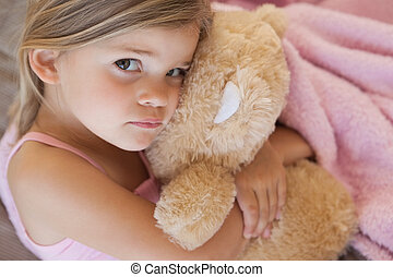 Close-up portrait of a girl with stuffed toy - Close-up...
