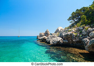 Clear turquoise water of Cala Luna in Sardinia - Cala Luna...