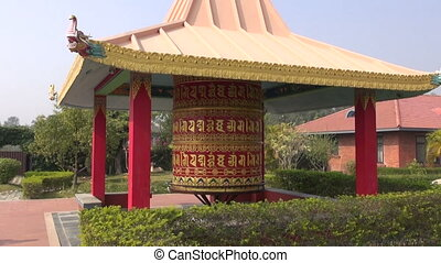 big beautiful buddhist prayer wheel in Lumbini, Nepal