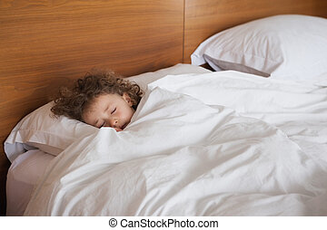 High angle view of a girl sleeping in bed - High angle view...
