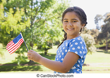 Girl holding the American flag at p