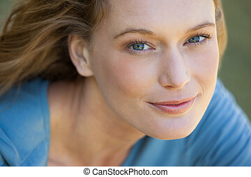 Close-up portrait of beautiful relaxed woman - Close-up...