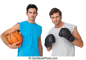 Fit men with boxing gloves and basketball - Portrait of two...