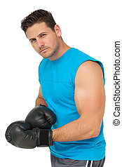 Portrait of a serious male boxer