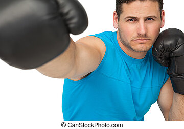 Close-up of a determined male boxer focused on training -...