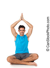 Full length portrait of a sporty men in meditation pose -...
