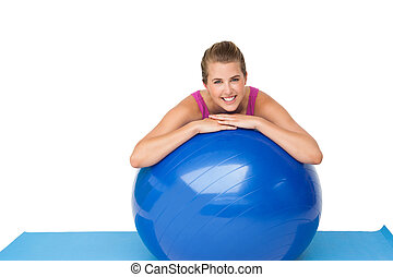 Portrait of a fit smiling woman with fitness ball - Portrait...