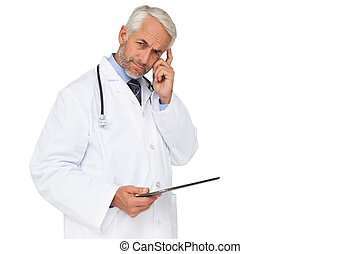 Portrait of a male doctor using digital tablet