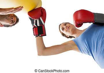Determined female boxer focused on her training over white...