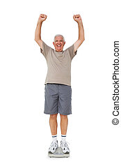 Senior man cheering on weight scale - Full length portrait...