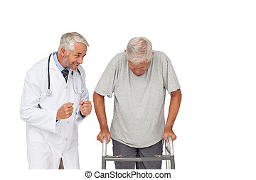 Doctor with senior man using walker over white background