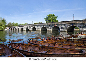 Boats on the river - A group of traditional rowing boats on...