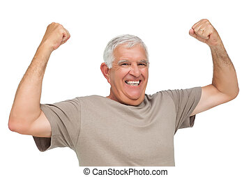 Portrait of a cheerful senior man with clenched fists over...