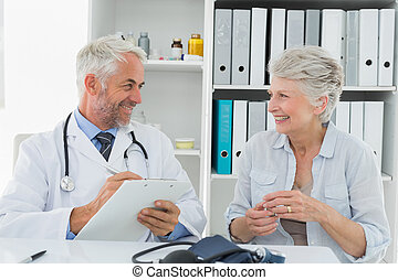 Female senior patient visiting doctor