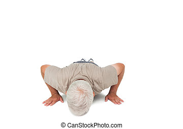Senior man doing push ups over white background