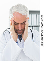 Close-up of a doctor with severe headache