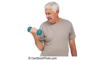 Portrait of a senior man exercising with dumbbell