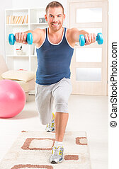 Handsome man doing exercises at home