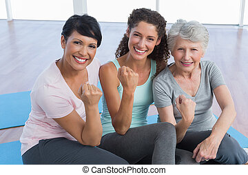 Portrait of happy women in yoga class