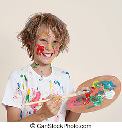 messy kid with paint pallete - messy kid painting with paint...