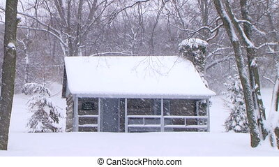Log Cabin in Snow - Peaceful setting of log cabin in winter...