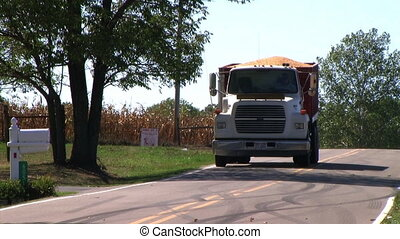 Truck Hauling Corn - Truck hauling load of corn from field -...