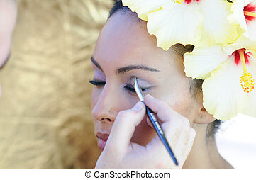 Professional makeup with a beautiful young black woman