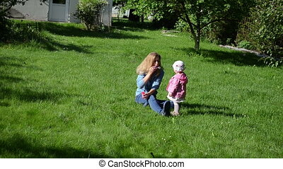 soap bubble family - mother and daughter have fun spending a...
