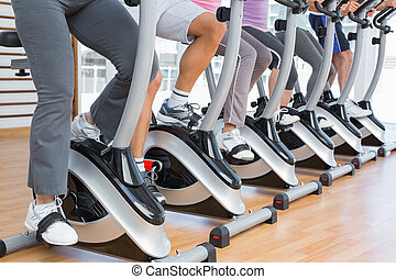Low section of people working out at spinning class - Low...