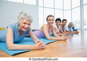 Fitness group lying in row at yoga class - Portrait of a...