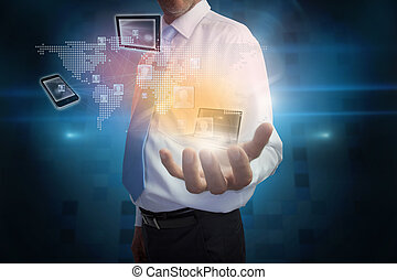 Businessman presenting interface with connecting devices -...