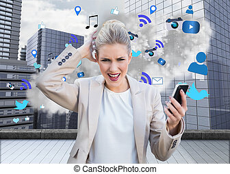 Digital composite of angry businesswoman holding smartphone...