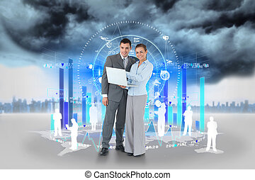 Digital composite of Happy business team using laptop with bar chart and human repesentations
