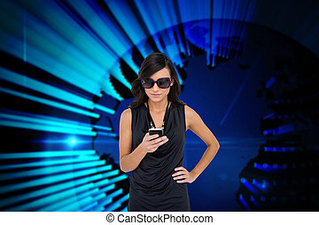 Digital composite of glamorous brunette using smartphone...