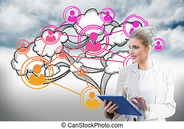 Digital composite of blonde businesswoman using tablet pc...