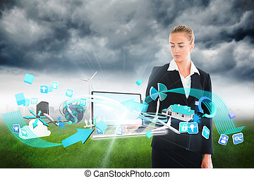 Blonde businesswoman touching lapto - Digital composite of...