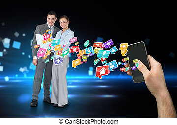 Digital composite of hand holding smartphone with app icons...