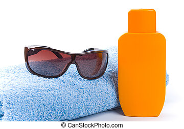 towel, sunglasses and lotion