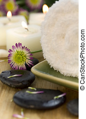 relaxation - Towel, flower, pebbles and candles spa therapy....