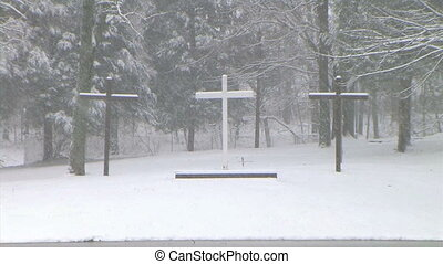 Crosses in Snow Zoom Out - Slow zoom out of crosses during...