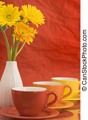 Color caps and yellow flowers - Row of color cups and...