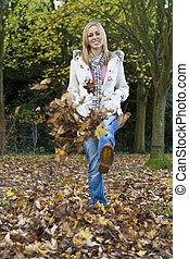 Woman Having Fun In The Fall