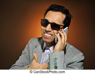 Young businessman talking on her phone