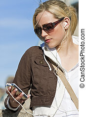 Beautiful Girl Listening to MP3 player - A beautiful young...