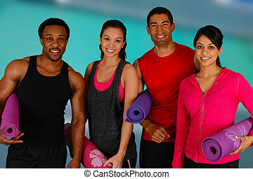 Yoga Workout - Group of people doing yoga while at the gym