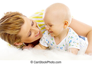 Mother and son - Young attractive mother kissing cute little...