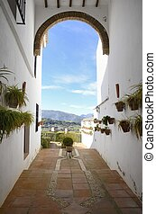 Mudejar arch with views to Ronda countryside, Andalusia,...