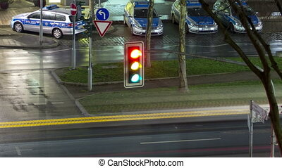 Traffic light in the city. Time Lapse.